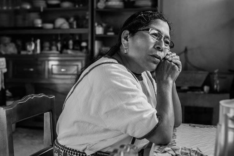 A Mixe woman reflects on her time in Milwaukee. She lived and worked there with her children until she had made enough money to build a house back home for her family. Her son stayed in Milwaukee with his wife and children, so she lives alone. Tamazulapam del Espiritu Santo, Oaxaca, Mexico.