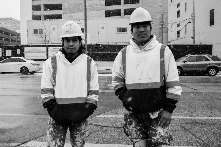 Mixe construction workers pose for a portrait in front of their worksite. Milwaukee, Wisconsin, USA.