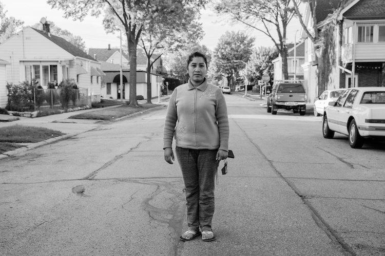 A single mom poses in the suburbs where she raises her two children. Milwaukee, Wisconsin, USA.